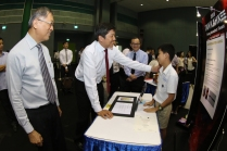 MIN congratulating Lee Kwan Tze (Commendation Award Winner from Nanyang Primary School) on his 'Match-A-Colour' invention – designed for the colour blind.