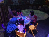 Children hard at work with their parents on some hands-on activities during the marine conservation programme!
