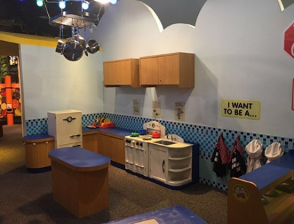A photo of the Cafe, where kids can try on different kid-sized work outfits and indulge into role-play as cafe chefs, street vendors and cashiers! The various miniature counters and kitchen models are sure to keep your child busy playing and learning!